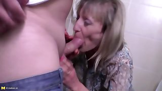 Pissing dam gets fucked in all her wet holes