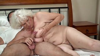 Horny granny gets her pussy serviced wits a young man