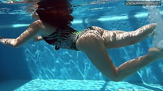 Spanish swimming wholesale Diana Rius shows striptease under the water