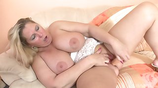 Busty blonde slut flashes her big tits with an increment of plays with her pussy