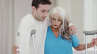 GILF physiotherapist Sally Dangelo gives a young man a lustful therapy