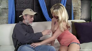 Small tits blonde enjoys having sex with an older guy on the sofa