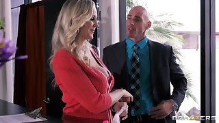 Busty secretary Julia Ann drops on her knees to please her boss