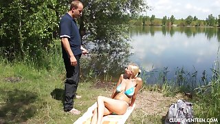 Nude appetency by the lake in a busty teen keen to suck dick